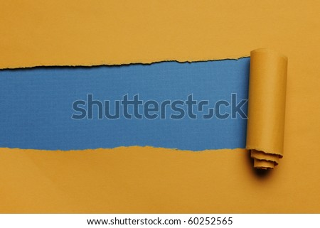 Rip Yellow Paper and blue background with space for text