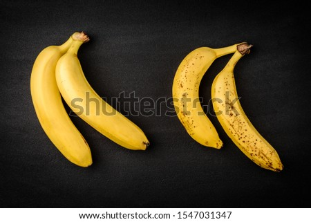 Ripe and over ripe banana on black background. #1547031347