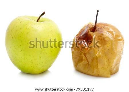 Ripe and rotten apple on a white background