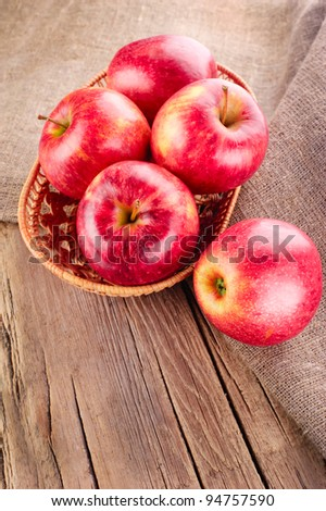 Ripe apple fruits on old wooden table with canvas tablecloth