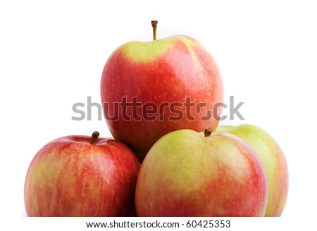 Ripe apples with one above others isolated on white