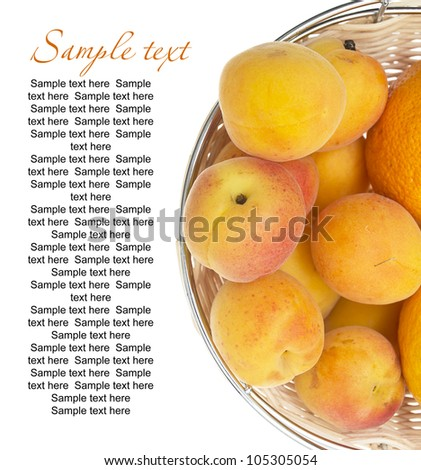 ripe apricots in bowl isolated on white background with sample text