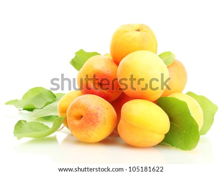 ripe apricots with green leaves isolated on white