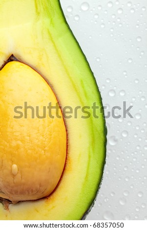Ripe avocado with drops of water