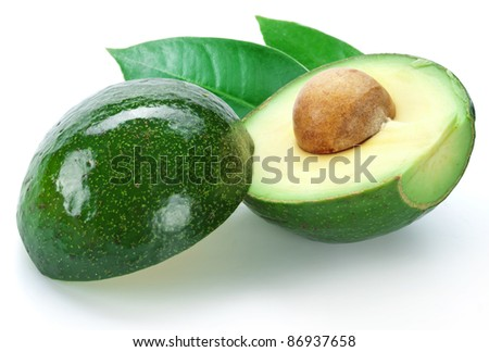 Ripe avocado with leaves on a white background.
