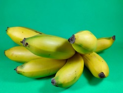 Ripe bananas are yellow with a greenish yellow background