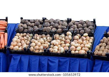 Ripe beets and onions in shop in a box