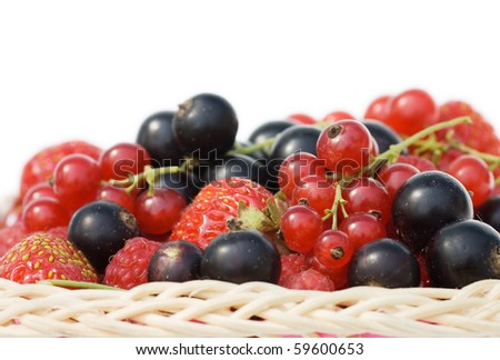 Ripe berries in a basket isolated on white background