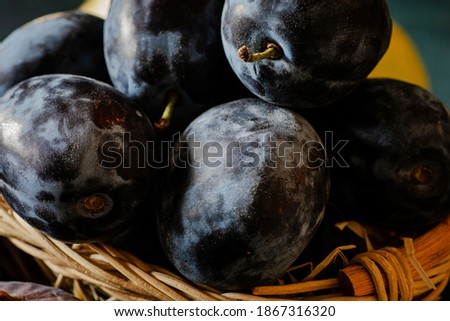 ripe blue plums in a basket