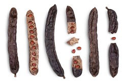 Ripe carob pods and bean isolated on white background with clipping path and full depth of field. Top view. Flat lay. Set or collection