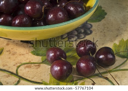 Ripe cherries in a bowl, on a vintage table,close up,studio shot
