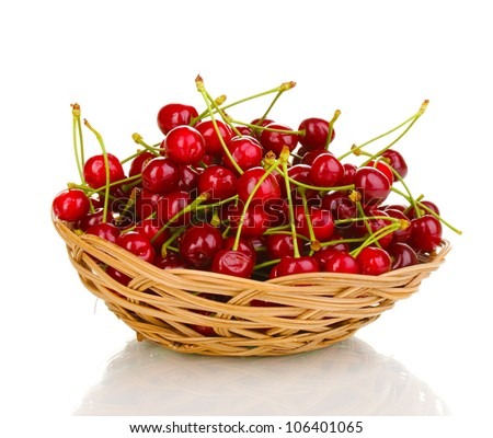 Ripe cherry berries in basket isolated on white