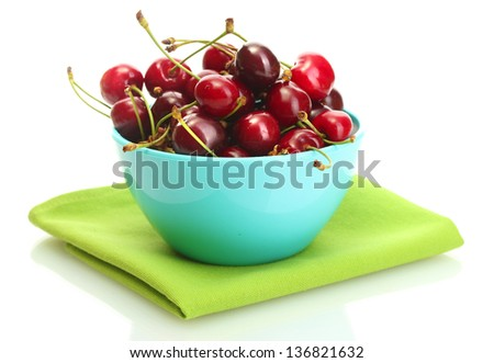 Ripe cherry berries in bowl isolated on white