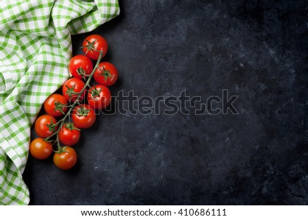 Ripe cherry tomatoes over stone kitchen table. Top view with copy space #410686111