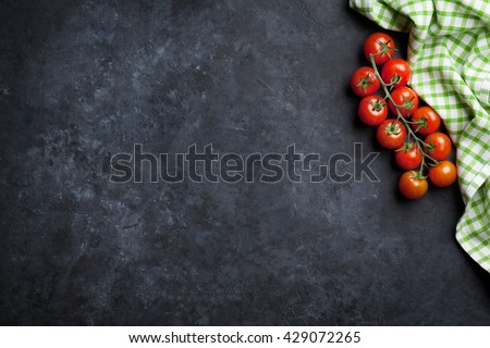 Ripe cherry tomatoes over stone kitchen table. Top view with copy space #429072265