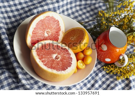 ripe citrus on  table with natural lighting