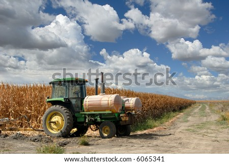 Ripe Corn and Lone Tractor At Harvest Time
