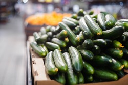 Ripe cucumbers at the grocery store. Vegetables are on the shelf at the farmers' market.