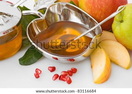 ripe  fresh apple  and honey for Rosh Hashana– jewish new year