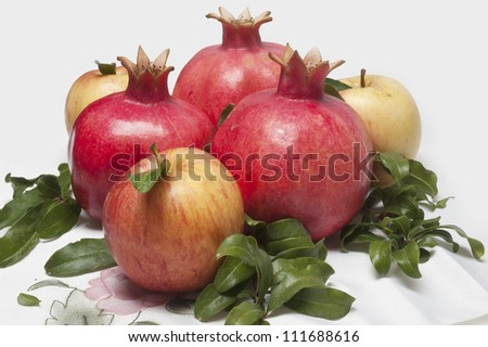 ripe fresh pomegranates with leaves