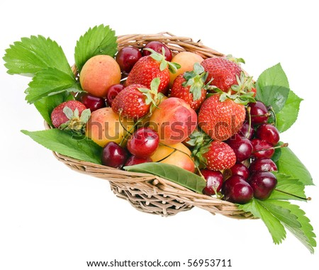 ripe fruit and berry in the basket isolated on white