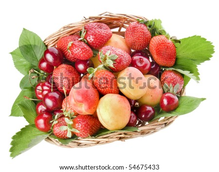 ripe fruit and berry in the basket top view surface close up isolated on white