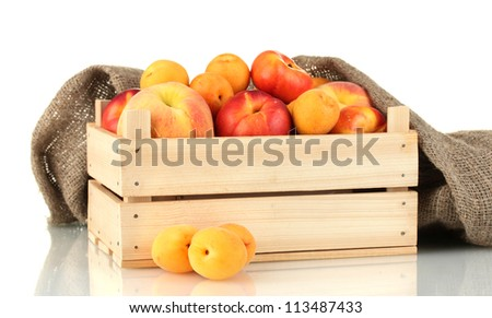 Ripe fruit in wooden box on white background close-up