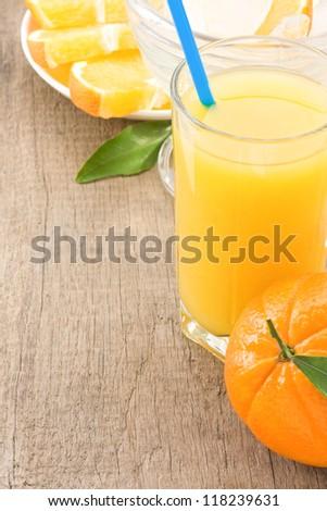 ripe fruits orange and juice at wood table background