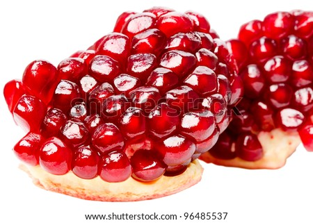 Ripe grains pomegranate isolated on white background