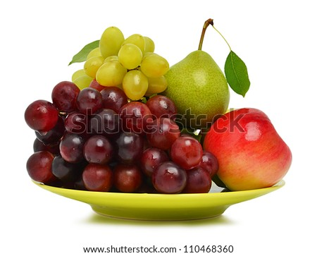 Ripe grape, the apple and pear on the plate isolated on the white background - stock photo
