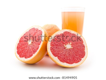 Ripe grapefruit and a glass of juice isolated on white background