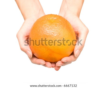 Ripe grapefruit in woman hands. Isolation on white.