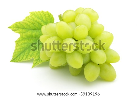 Ripe grapes with leaves - stock photo