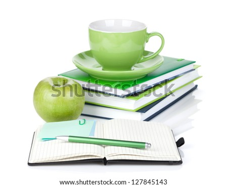Ripe green apple, coffee cup and office supplies. Isolated on white background