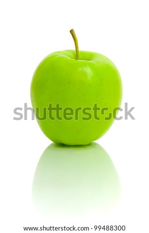 ripe green apple on a white background with reflection closeup