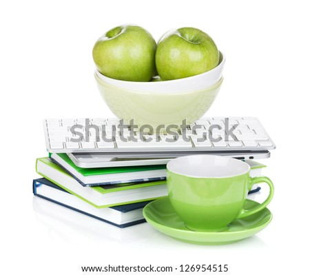 Ripe green apples, coffee cup and office supplies. Isolated on white background