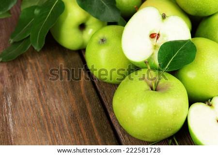 Ripe green apples on wooden background