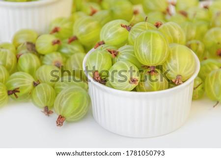 Ripe green gooseberry berry. Green gooseberry isolated on white background Stock photo ©