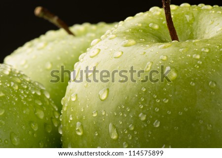 Ripe green Granny Smith Apple with water drops
