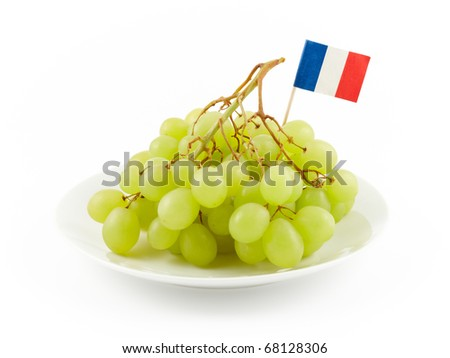 ripe green grapes on a dish isolated on white