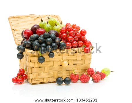 ripe juicy berries in a wicker basket on a white background