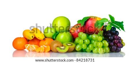 Ripe juicy fruits isolated on white - stock photo