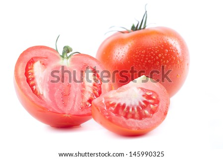 ripe juicy tomatoes on a white background