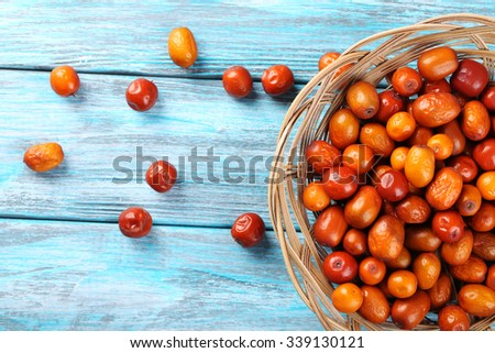 Ripe jujubes on blue wooden table, close up #339130121