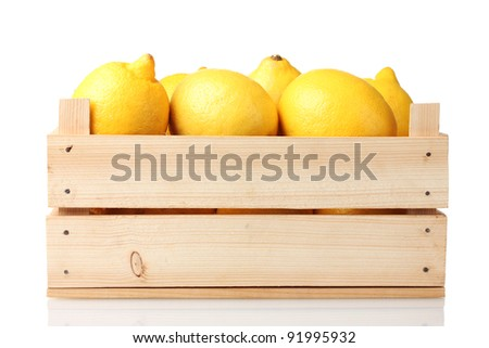 ripe lemon in wooden box isolated on white