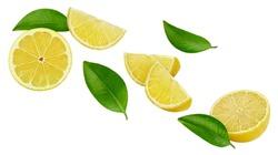 Ripe lemon slices isolated on white background. Ripe lemon with leaves clipping path. Flying lemon fruits