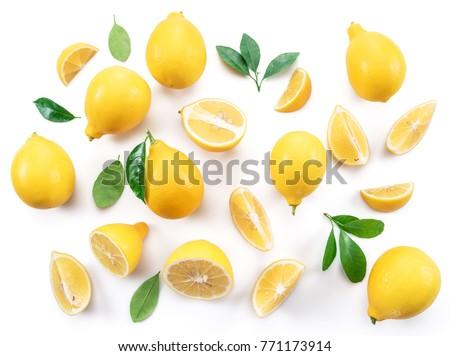 Ripe lemons and lemon leaves on white background. Top view.