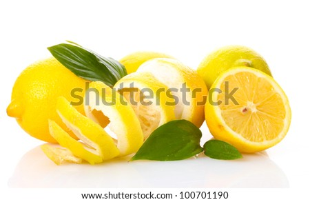 ripe lemons with leaves isolated on white
