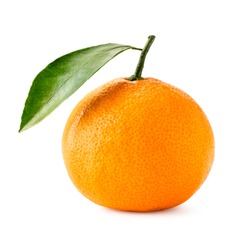 Ripe mandarin with a green leaf close-up on a white. Isolated.