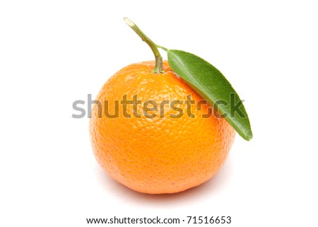 Ripe mandarin with green leaf isolated on white background